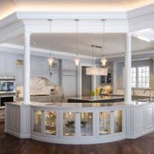 French Country Kitchen With Open Plan Curved Bar Glittering Lights Pillars