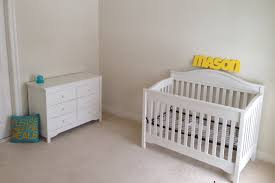 cozy berber carpet with white tar baby cribs and white nightstand for cozy nursery design