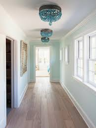 chandeliers design wonderful blue hallway with brass