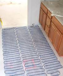 installing in floor heating tile courtesy a heated floor