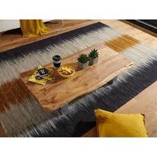 wohnling couchtisch asura 115 x 25 x 58 cm akazie massiv holz metallgestell groß baumstamm wohnzimmertisch massivholz braun baumkante sofatisch