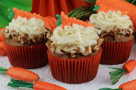 Carrot Cake Cupcakes with Cream Cheese Frosting Carrots and cinnamon bine in a moist and