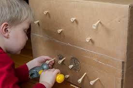 Pound Tees Into A Cardboard Box