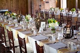 Rustic Country Wedding Reception Decorations With White Flowers And Small Lanterns On Long Tables Also Wooden Chairs