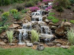 Lawn & Garden : Awesome Three Level Stone Waterfall In Backyard ... Cute Water Lilies And Koi Fish In Modern Garden Pond Idea With 25 Unique Waterfall Ideas On Pinterest Backyard Water You Invest A Lot In Your Pond Especially Stocking Save Excellent Garden Waterfalls Design Of Backyard Fulls Unique Stone Waterfalls Architecturenice Simple Diy House Design Small Ponds Beautiful To Complete Your Home Ideas Download Pictures Of Landscaping Outdoor Building Best Rock Diy Natural For Exterior Falls