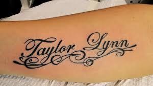 Amazing Taylor Lynn Name Tattoo On Forearm