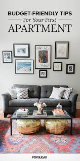 Living Room With Gray Sofa Gallery Wall And Gold Poufs Affordable Decor