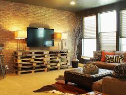 rustic living room with custom pallet table and brick wall
