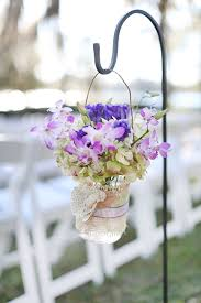 Aisle arrangements on shepard s hooks Flowers by Lee Forrest