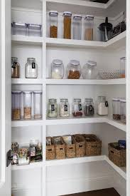 White Stacked Pantry Shelves With Labeled Mason Jars