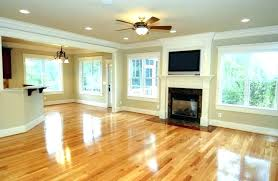 Dark Cabinets And Flooring With Wood Floors White Black Countertops
