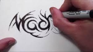 Custom Hidden Tribal Name Tattoo Design