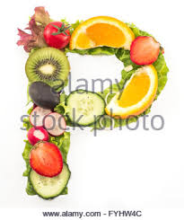 Letter L made of salad and fruits Stock Royalty Free Image