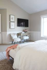 Gorgeous Bedroom Features Beige Paint On Upper Walls And Wainscoting Lower Framing Flatscreen TV
