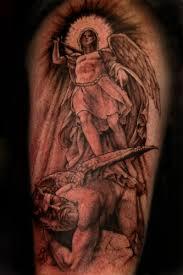 30 Bewitching Catholic Cross Tattoos For Men