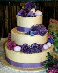 Romantic Three Tier Round Purple And Cream Wedding Cake Decorated With Ribbon