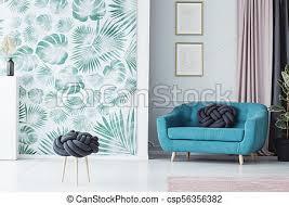 türkis sofa im wohnzimmer knot kissen auf türkises sofa
