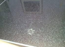 how do i remove grout haze marks from black granite floor