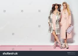 fashionable two women coat nice dress stock photo 509503144