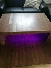 wohnzimmertisch gefliest mit led lichtband in bayern