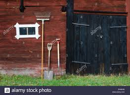 Garden Tools At An Old Barn Wall Stock Photo, Royalty Free Image ... Mortenson Cstruction Incporates 100yearold Barn Into New Old Wall Of Wooden Sheds Stock Image Image Backdrop 36177723 Barnwood Wall Decor Iron Blog Wood Farm Old Weathered Background Stock Cracked Red Paint On An Photo Royalty Free Fragment Of Beaufitul Barn From The Begning 20th Vine Climbing 812513 Johnson Restoration And Cversion Horizontal Red Board 427079443 Architects Paper Wallpaper 1 470423