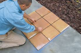 place and align the tiles how to lay tile a concrete patio