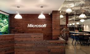 Office Workspace Microsoft Reception Desk With Rustic Wood Style Design And Industrial Lighting