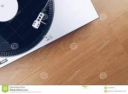 Top View Of A Record Player Or Turntable With Vinyl On The Wooden Floor