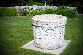 decorative well pump covers concrete landscape design