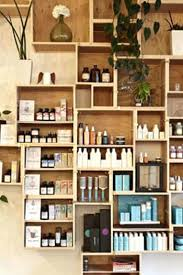 Salon Retail Display Shelves Get Creative With Your Product Wall Original Decorating Ideas On