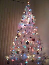 white tree with multicolor lights decore