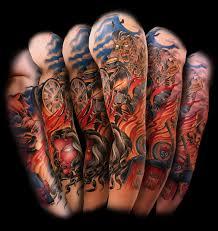 Colored Moto Tattoo On Sleeve