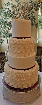 Four Tier Buttercream Wedding Cake Decorated With Rosettes And Sugar Crystals Delivered At The Out