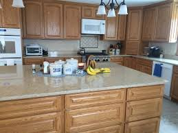 Kitchen Backsplash Pictures With Oak Cabinets by Open Kitchen With Quartz Counters And Oak Cabinets Beautiful
