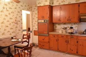 This Kitchen Is So Much Like Betty Drapers And While It Was The Height Of Piney Woodsy Suburban Chic Back In 60s That Look Doesnt Translate Well