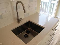 kitchen silver arched crane above kitchen sink on