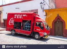 Coca Cola Truck Making Delivery On A Street In San Miguel De Allende ... What Every Coca Cola Driver Does Day Of The Year Makeithappy Dash Cam Viral Video Captures An Audi Driving Do This Dangerous Move Cacola Bus Spotted In Ldon As The Countdown To Christmas Starts Truck Coca Cola This Is Why The Truck Isnt Coming To Surrey Transportation Technology Wises Up Autonomous Vehicles Uberization Lorry In Coventry City Centre Contrylive Showcase Cinema Property Revived Coke Build Facility Erlanger Teamsters Pladelphia Distributor Agree New 5year Driver Youtube Health Chief Hits Out At Tour West