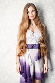 beautiful with magnificent long hair posing in evening dress