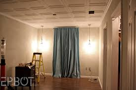 ceiling hanging lighting and styrofoam ceiling tiles and curtain