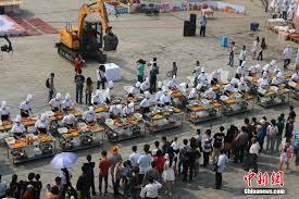 Worlds Heaviest Pumpkin Pie by Excavators Used To Make World U0027s Largest Chinese Pumpkin Pie