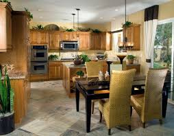 In A More Contemporary Setting This Kitchen Features Lush Natural Wood Cabinetry Over Stone Tile