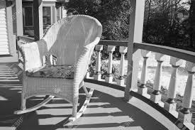 A Wicker Rocking Chair On A Porch In Black And White. Kampmann Outdoor Wicker Rocking Chair With Cushions Harmony Patio Blackwhite Mesh Cast Alinum Frame On Porch Black Resin Indoor Chairs Elegant 52 Currituck Sophisticated Relaxing Ratan Fniture Acceptable Antique Prices Buy Pricesratan 3pc Rocker Set With Brick Red Cushion Intertional Caravan San Tropez Gliders Rockers Sale Kmart Childrens
