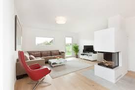 wohnzimmer mit kamin talbau haus gmbh moderne wohnzimmer