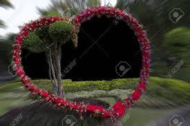 coeur cadre de fleurs pour le mariage ou la valentin banque