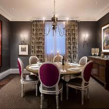 Inspiration For A Timeless Dark Wood Floor Dining Room Remodel In London With Brown Walls
