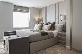 A Cushioned Accent Wall Does The Job Of Headboard While Also Creating Interest For