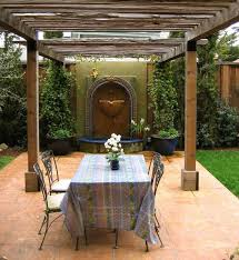 Dining Furniture And Wall Fountain For Backyard Design In Tuscan Style