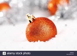 Orange Glitter Christmas Tree Balls On Snow With Decorations