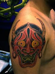 Color Ink Asian Tattoo On Right Shoulder