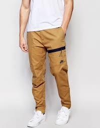 beige bonded woven pants by nike soletopia